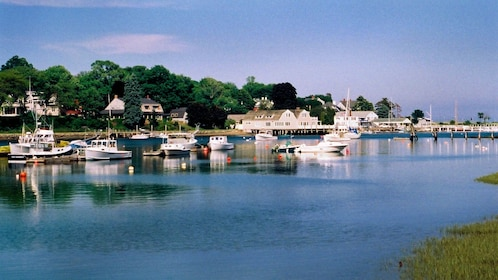 Boats docked in a small harbor on the New England coast