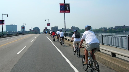 Bicycling group on a bridge in Boston