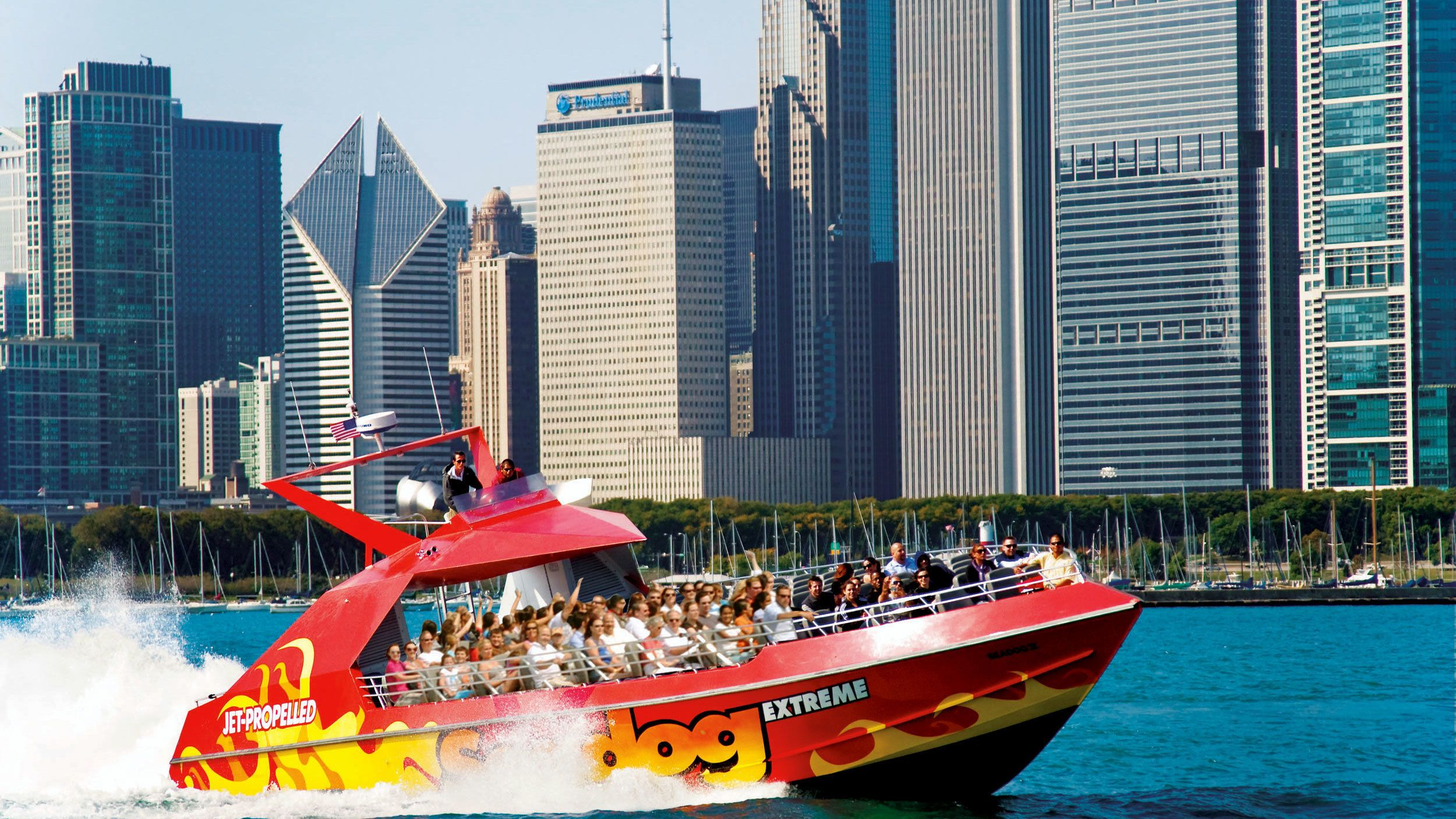 red speed boat on lake michigan in chicago