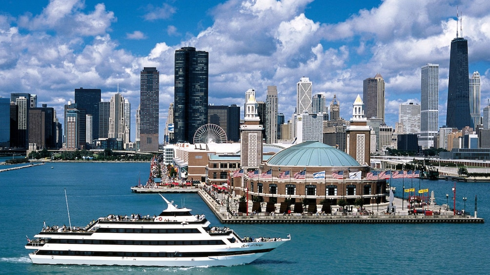 Show item 1 of 2. cruise ship sailing past the navy pier in chicago