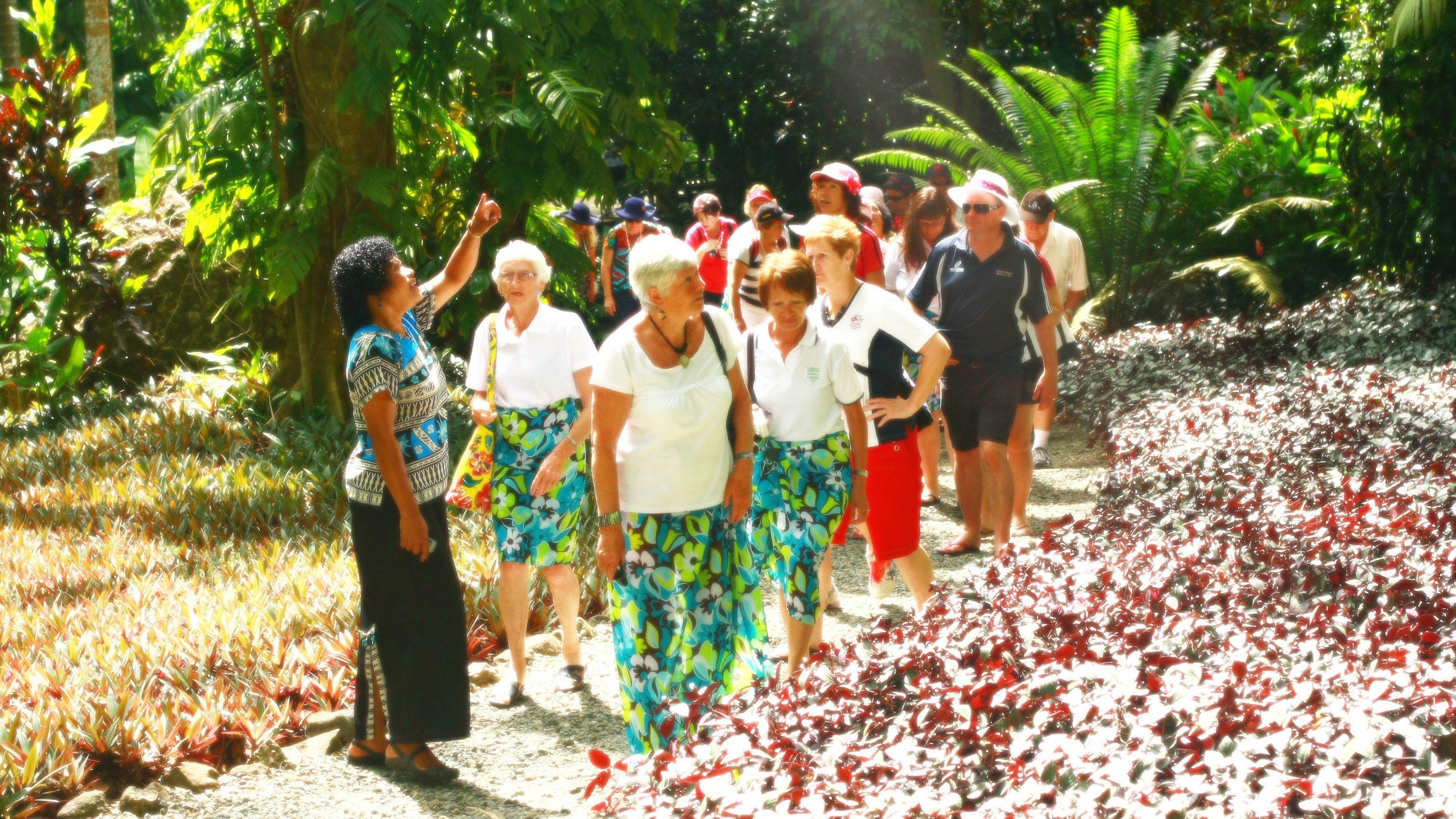 group walking leisurely along a trail in Fiji