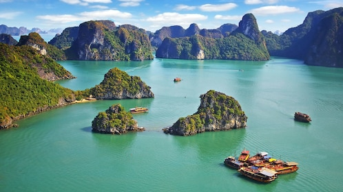 boats near small island clusters in Vietnam