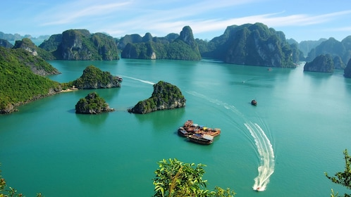 Jet boat speeding past small islands in Vietnam