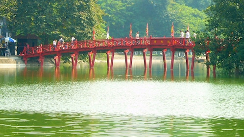 crossing a red bridge above the water in Vietnam