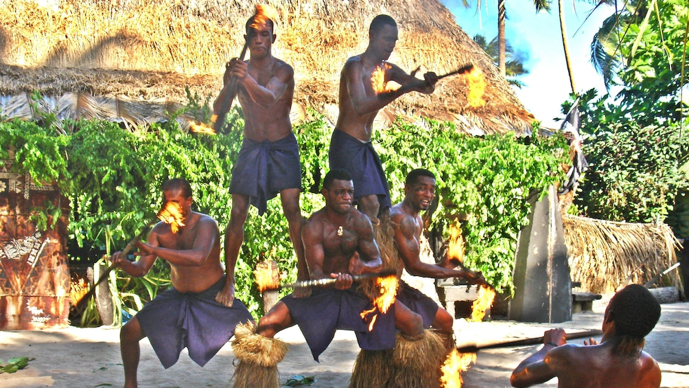 Show item 2 of 5. performers with torches at Robinson Crusoe Island in Fiji