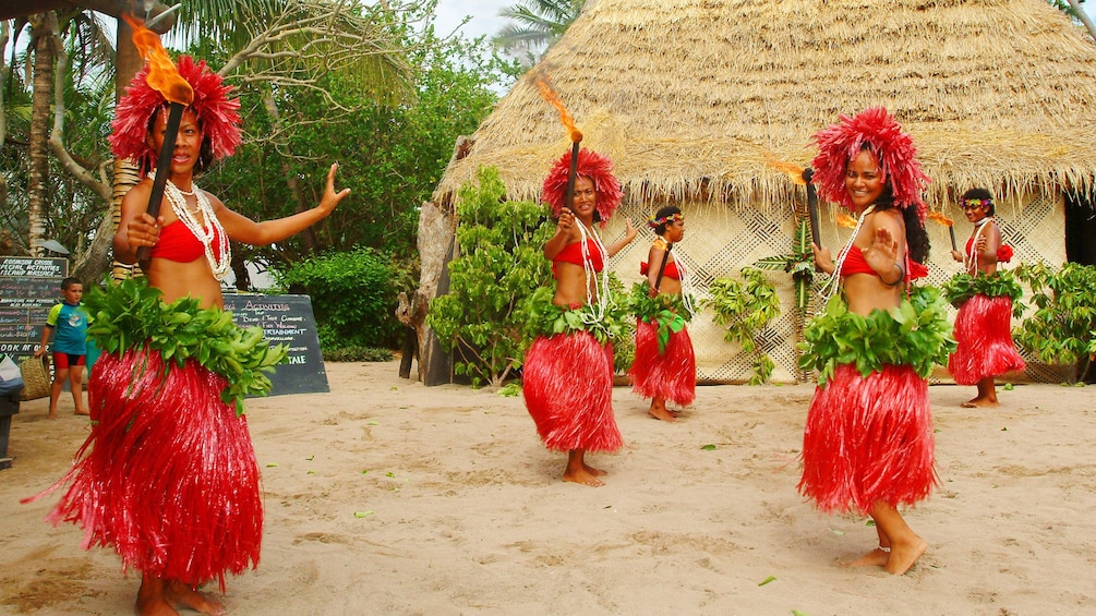 Show item 1 of 5. tribeswomen dancing with torches at Robinson Crusoe Island in Fiji