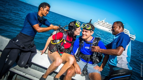 divers suiting up on the boat in Fiji