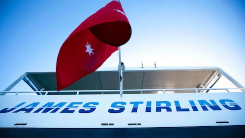 The Australian flag on the stern of a cruise ship on the swan river