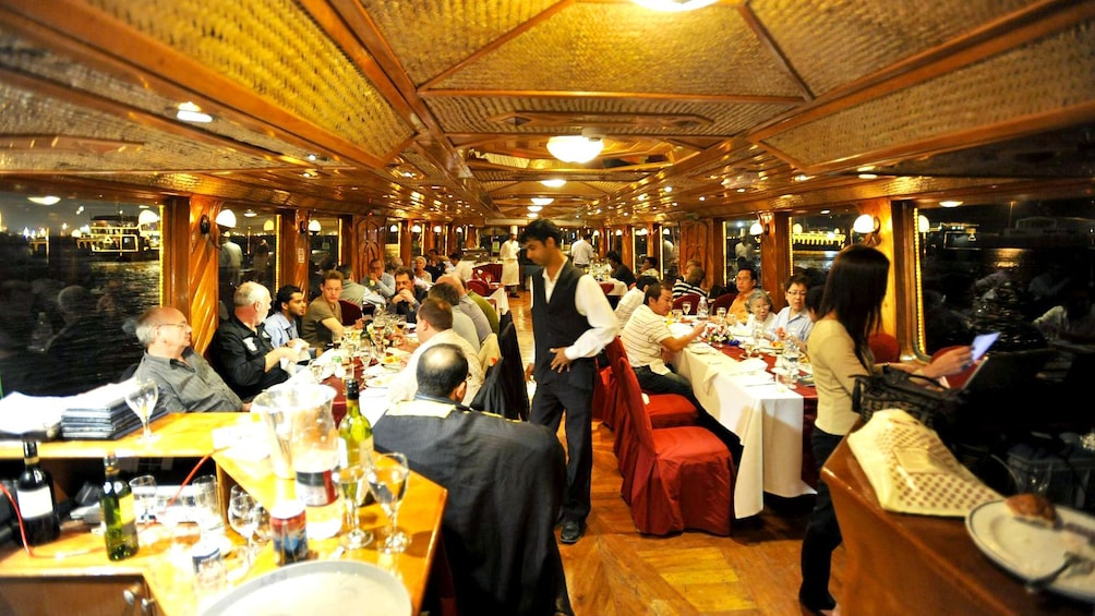 guests on boat eating dinner in Abu Dhabi