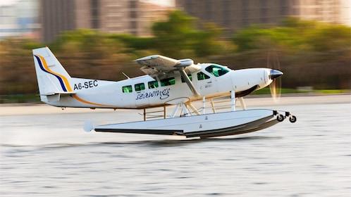 Sea plane taking off from water in Abu Dhabi