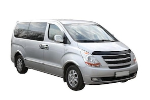 Transfer in private minivan from Calgary Downtown to Calgary Airport (YYC)