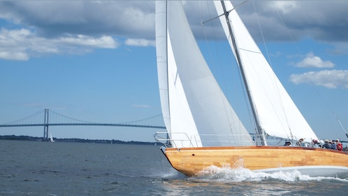 Sailboat making a wide turn in the water at Newport