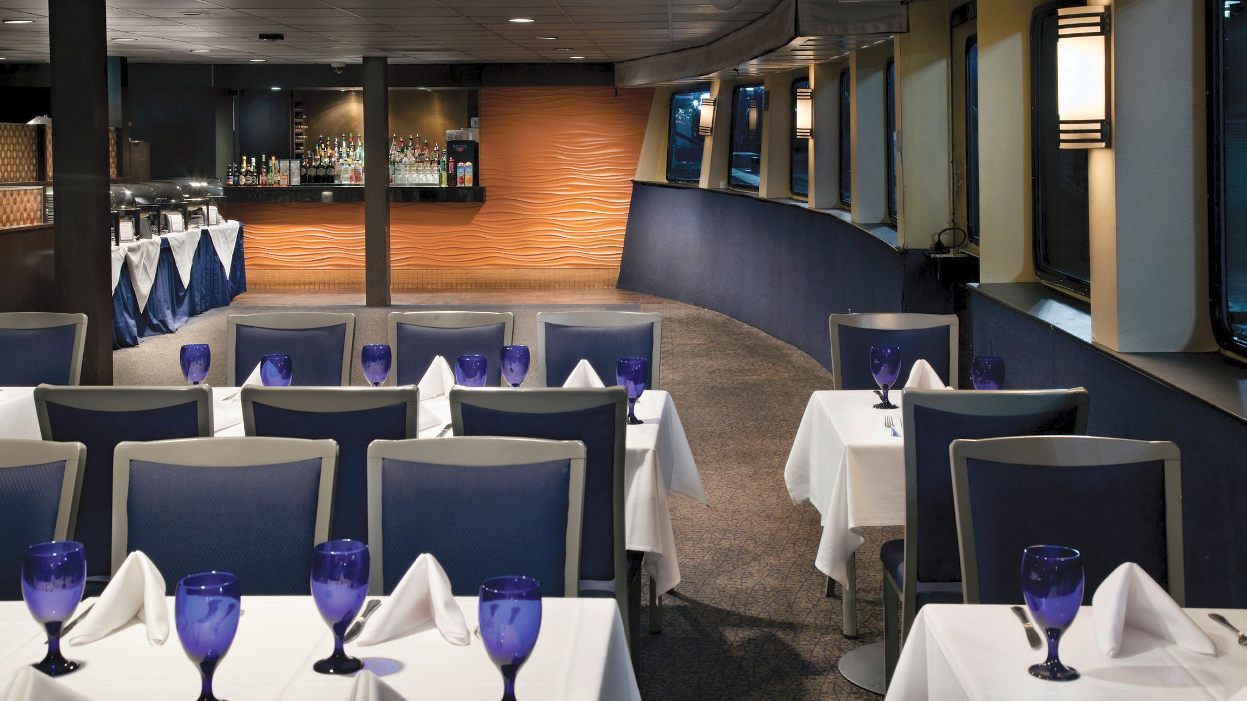 Elegant dining hall with full service bar in the Spirit of Baltimore cruise ship