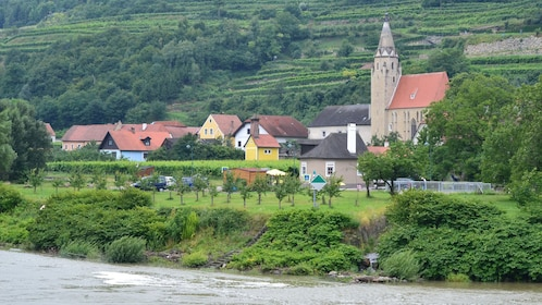 Small village surrounded by forests and vineyards along the River Danube