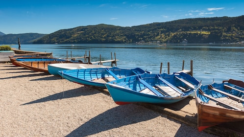 Row boats lined up on the sand of the bank of the River Danube