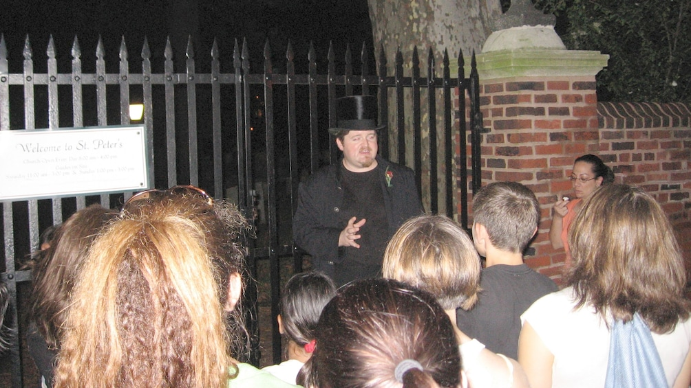 Show item 1 of 5. Ghost Tour at the gates of St Peter's Church at night in Philadelphia