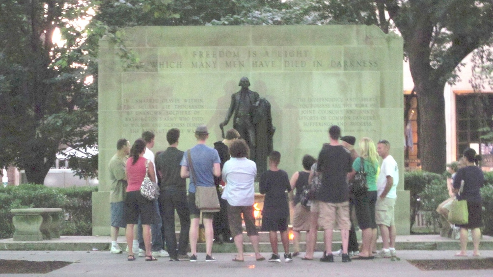 Show item 5 of 5. Tour group at the Tomb of the Unknown Revolutionary War Soldier in Philadelphia