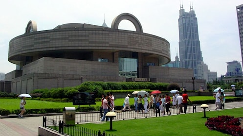 People walking in front of the Shanghai Museum in Shanghai