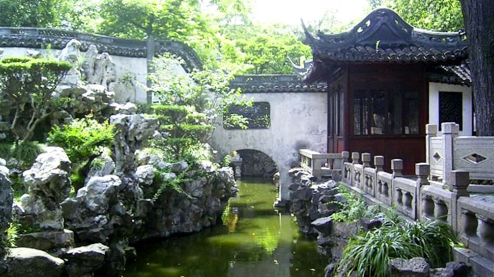 Show item 10 of 10. Pond bridge and building above water in Shanghai