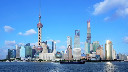 Shanghai skyline with skyscrapers and blue skies over the Huangpu River