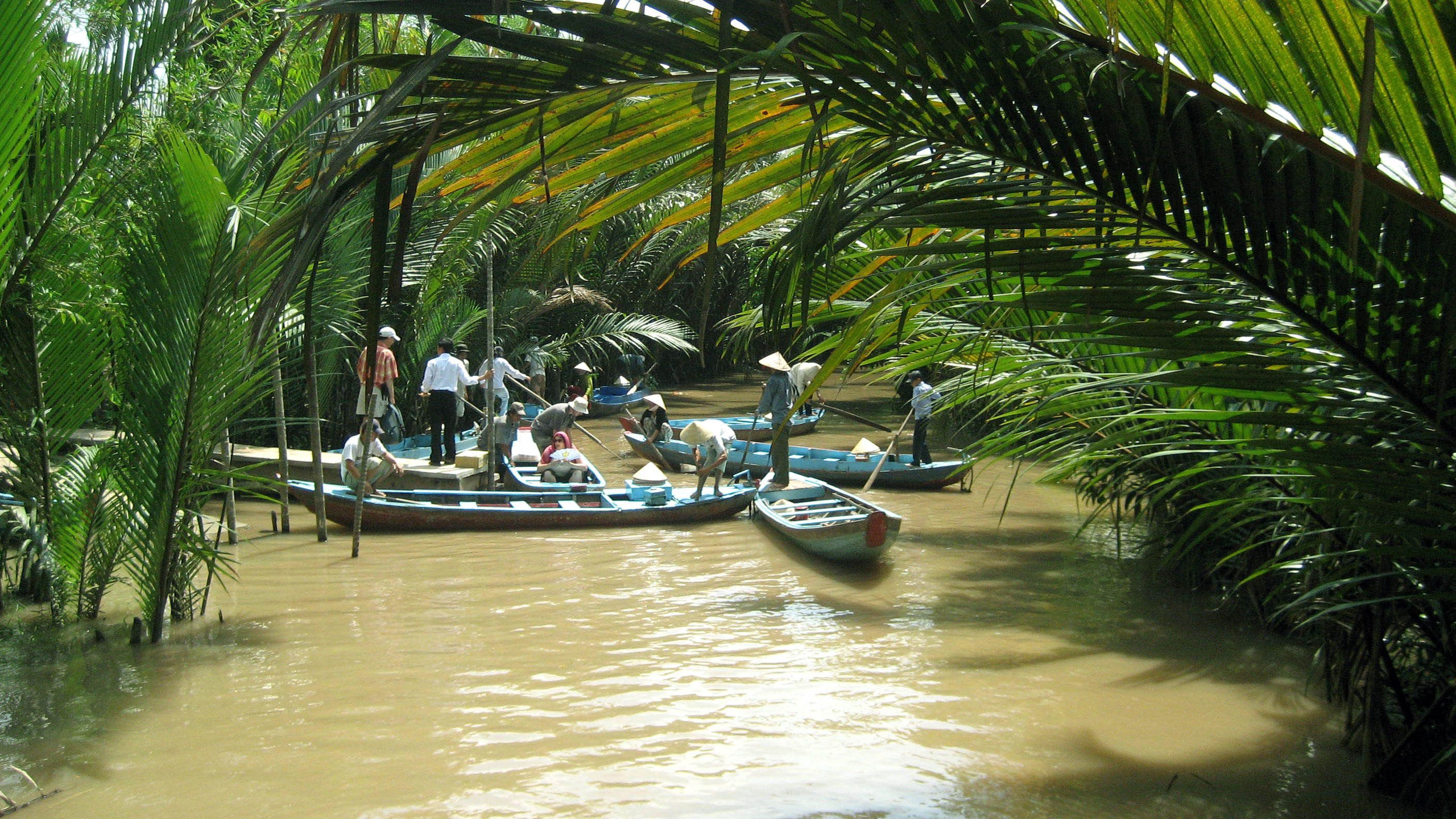 View of the Mekong river with boats in the wter in Vietnam