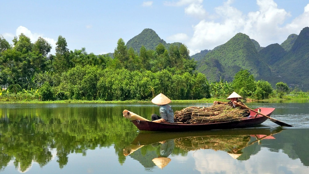 Show item 1 of 10. Motorboat in Cái Bè to visit its lively floating market along the Tien River in Vietnam