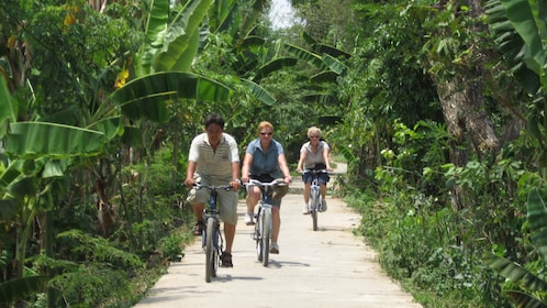 Tourists bicycling on the streets of Vietnam