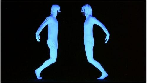Two black light dancers
