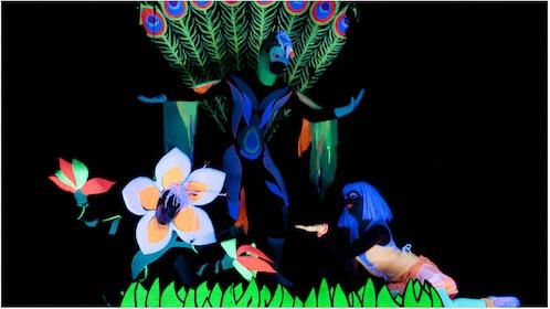 Black light dancers in a black light garden