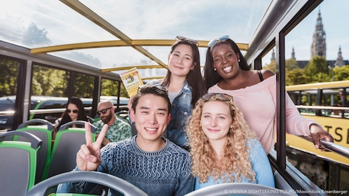 Group posing for picture in Hop-On Hop-Off bus in Vienna