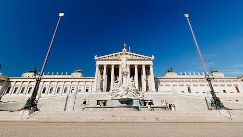 Statue standing in front of the parliament building in Vienna