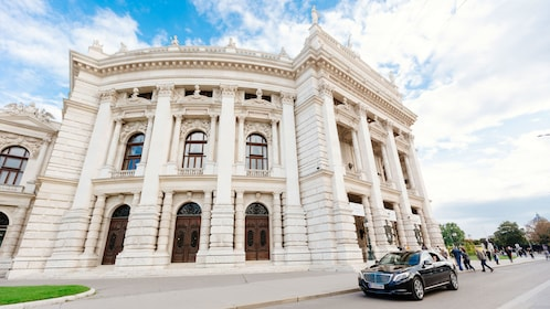 Car waits outside of building in Vienna