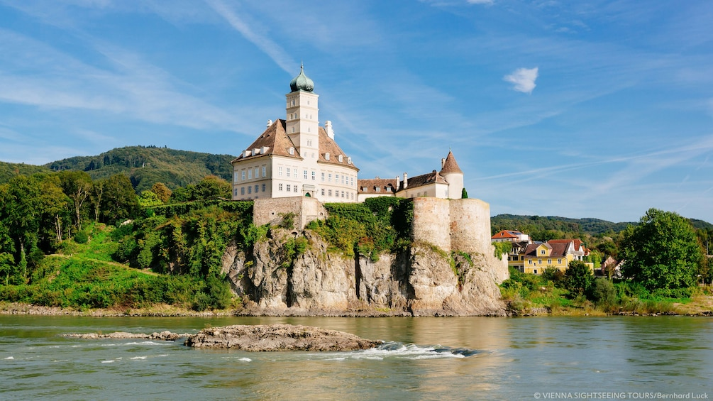 View of castle overlooking river in Wachau
