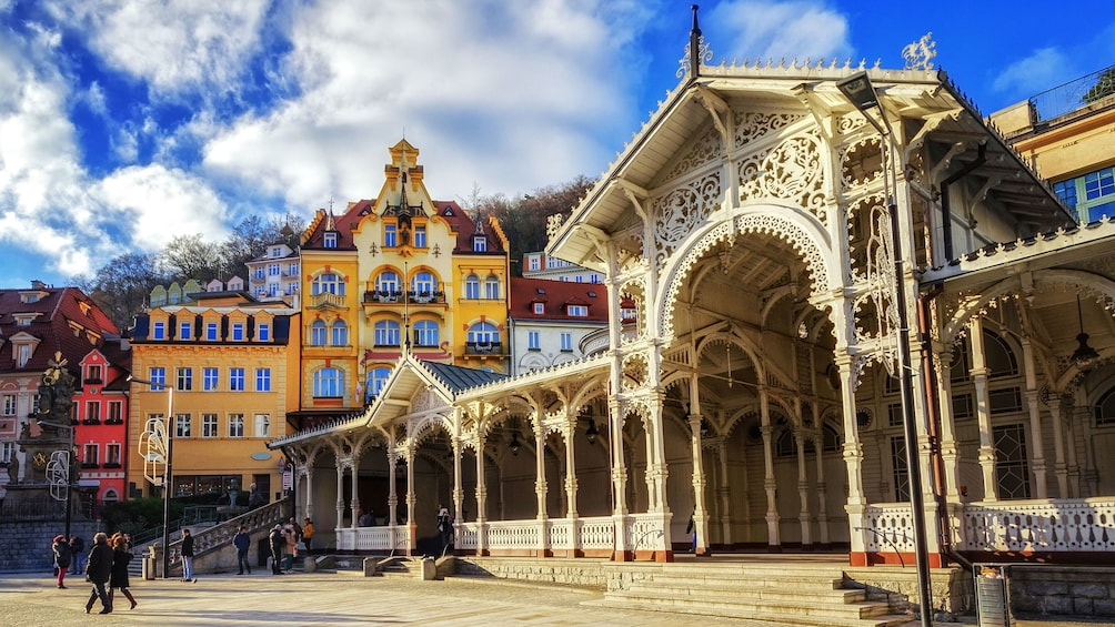 Show item 1 of 10. The white wooden building of the Market Colonnade in Karlovy Vary