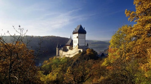 Karlstejn Castle perched on a hilltop with valley in the distance in the Czech Republic