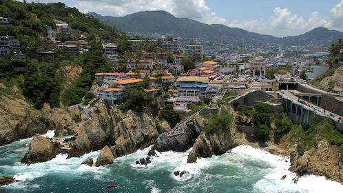 Rocky coastline and city of Acapulco