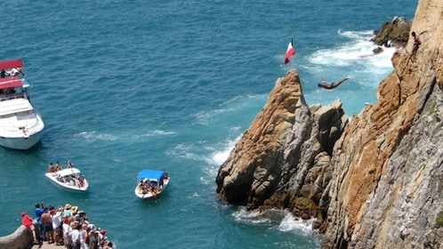 Group watching a cliff diver in Acapulco