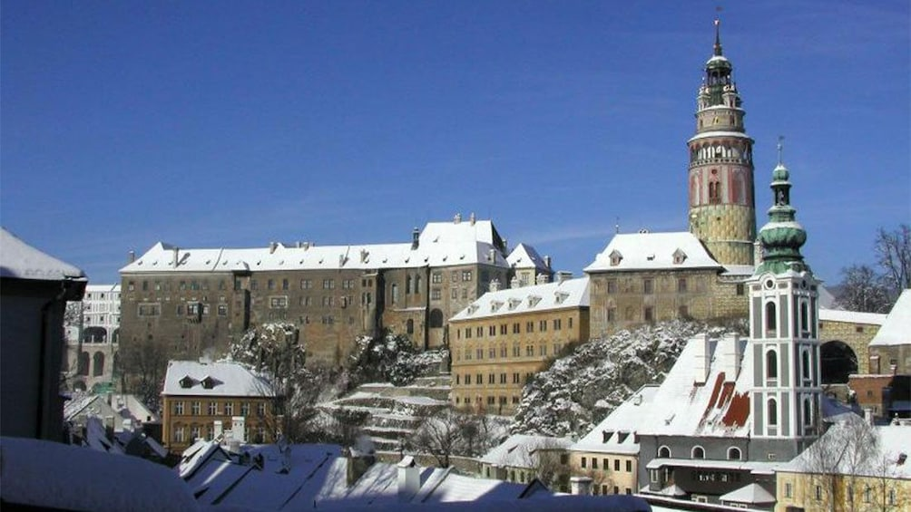 Show item 3 of 10. Snow-topped roofs of the city and Castle in Cesky Krumlov