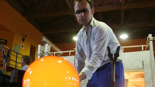Glassblower creating his next masterpiece at the Nizbor Glass Factory in Prague