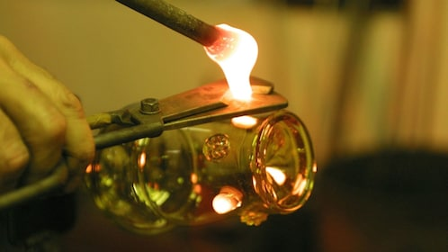 Close up of a torch blowing glass at the Nizbor Glass Factory in Prague