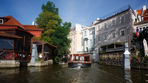 Tour boat on a narrow canal in Prague