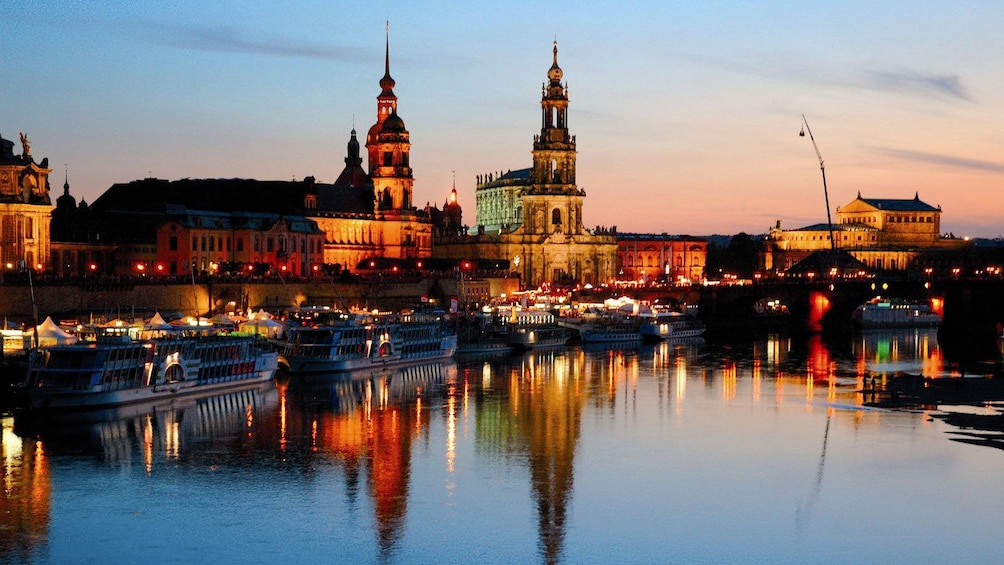 Show item 3 of 10. City along the river lit up at night in Dresden