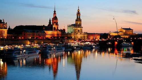 City along the river lit up at night in Dresden
