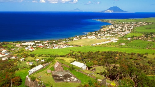 Panoramic view of a seaside village surrounded by farmland in St Lucia