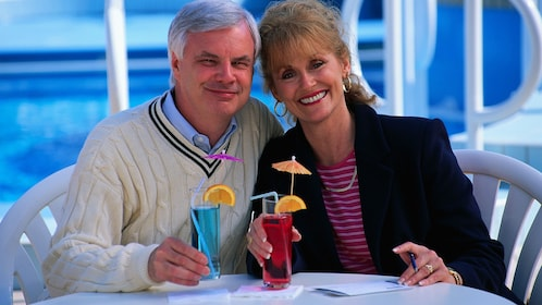 Mature couple enjoying cocktails on a boat in St Lucia