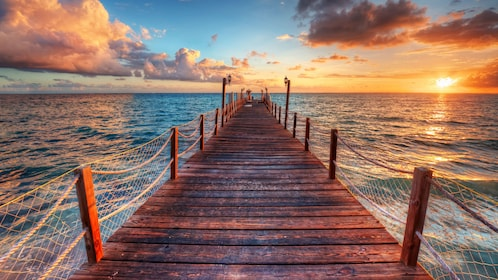 Long pier over the the water at sunset in St Lucia