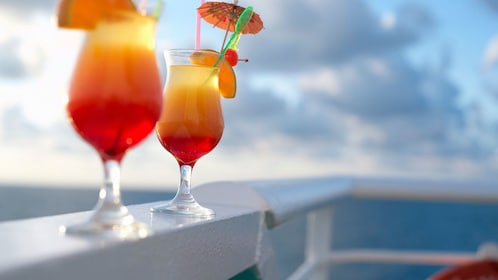 Pair of tropical cocktails on the railing of a cruise boat in St Lucia