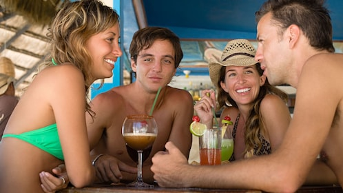 Group of young people with cocktails on a boat in St Lucia