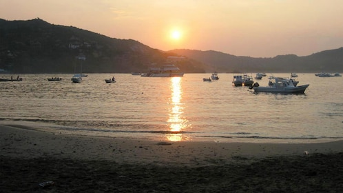 Boats on the water at sunset in Ixtapa