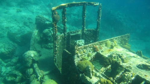 Picturesque sunken tugboat in Curacao